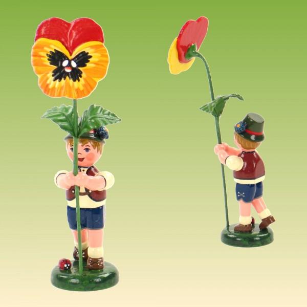 Blumenkind Junge mit Stiefmütterchen