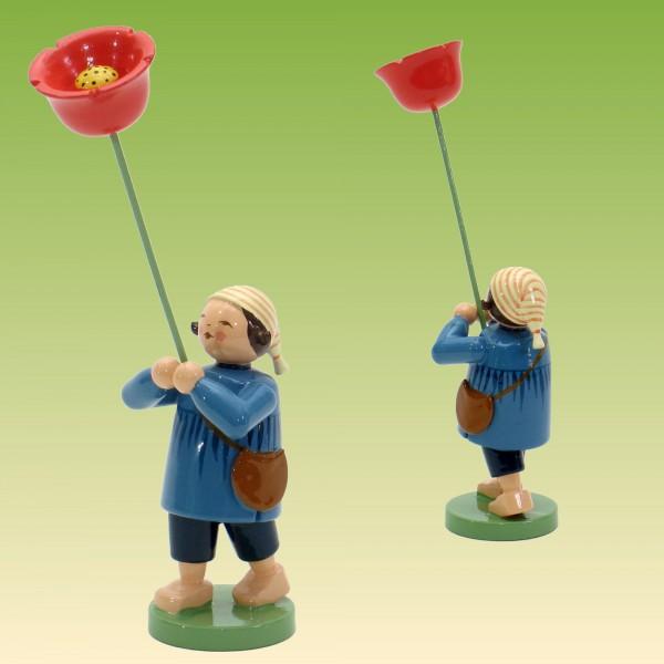 Blumenkind Junge mit Mohnblume