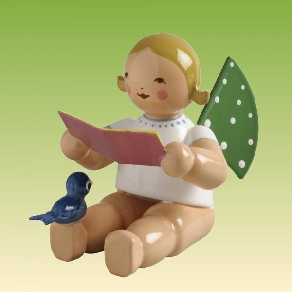 Engel mit Notenblatt und Vogel