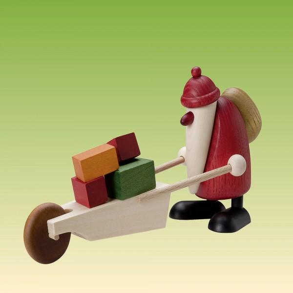 Weihnachtsmann mit Schubkarre und Geschenke