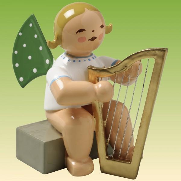 Engel mit Harfe sitzend