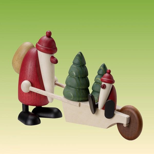 Weihnachtsmann mit Schubkarre und Kind